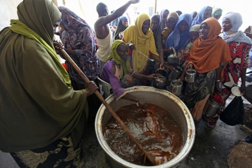 146936-a-displaced-somali-prepares-to-serve-food-at-a-camp-in-hodan-district-