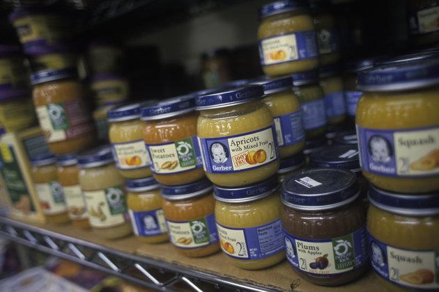 Jars of Gerber baby food on shelves at a Shoprite Supermarket.